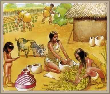 mujer muele grano